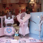 In the shop window of the Le Boudoir de Marie shop, featuring picture, postcards and badges